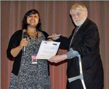 Griffith Vaughan Williams presents the certificate to Nazmia Jamal.